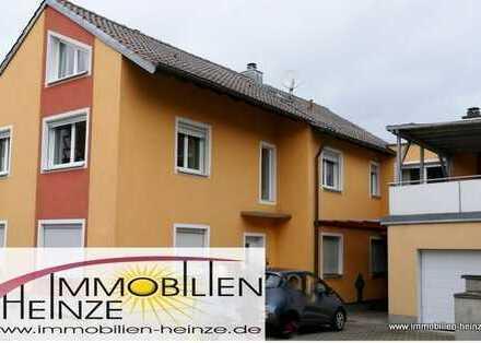 # Herrliche Wohnung im Zwei-Familienhaus mit Garage, EBK + Ausbaureserve für die wachsende Familie!