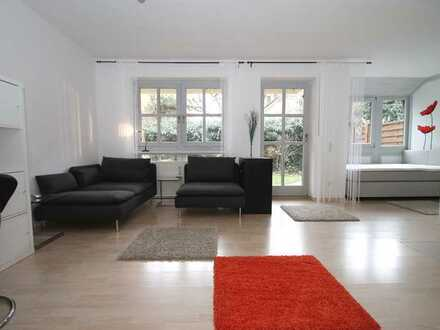 Gut geschnittene & ruhige 1-Zimmer Wohnung direkt im Zentrum mit Terrasse und eig. Garten (möbliert)