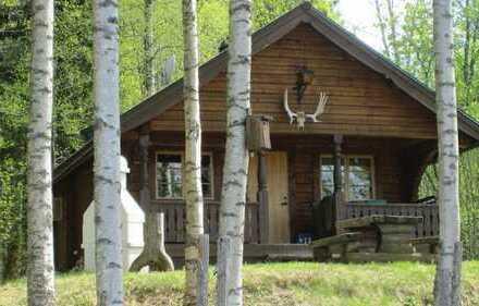 Massives Holzblockhaus am See
