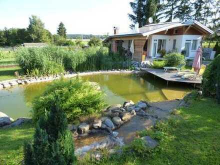 Ferienhaus (ganzjährig bewohnbar) mit Baugrundstück (678m²) und schöner Freizeitanlage