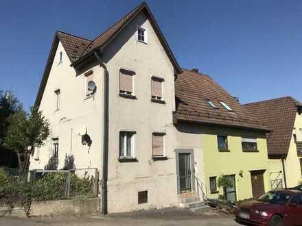 Grundstück mit modernisierungsbedürftiger Doppelhaushälfte oder für Neubau