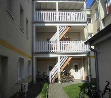 WG-geeignet: 2-Zimmer-Wohnung mit Einbauküche in der Alten Buchdruckerei im Zentrum Greifswalds