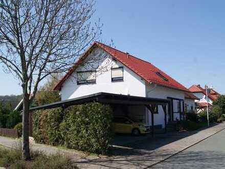 Hübsches Einfamilienhaus mit Einliegerwohnung in attraktiver und ruhiger Wohnlage im Grünen.
