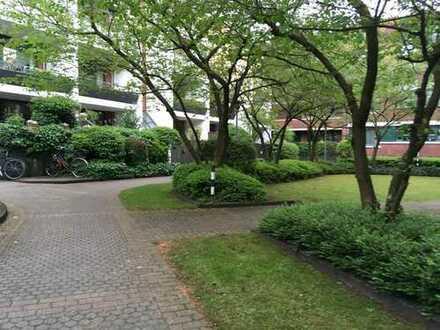 2 Zimmer mit großer Terrasse, ruhige Lage im Innenhof, mit Tiefgaragenstellplatz