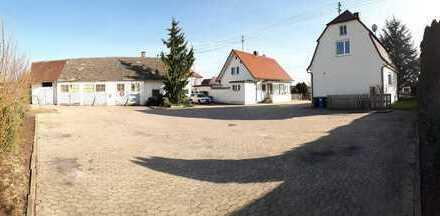 Grundstück (1915 qm) inkl. 2 Einfamilienhäusern + Werkstatthalle + Garage + Bauplatz