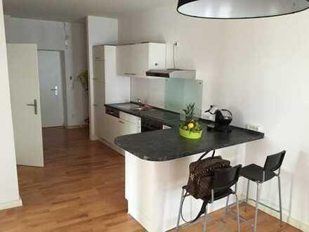 Stilvolle, 2-Zimmer mit Küche, eine Gemeinschaftsterrasse und Waschküche