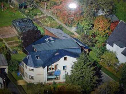 Wohnhaus mit 3 Wohnungen in Ortsrandlage!