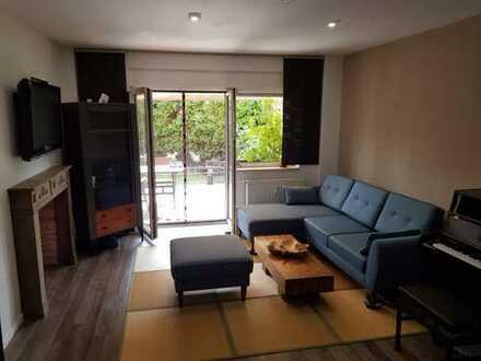 -reserviert- gepflegte Maisonettewohnung mit Endreihenhaus-Charakter, Terrasse und Garten