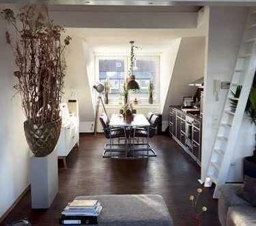 Offenes Wohnen in stilvoller Architektenwohnung mit großem Westbalkon über den Dächern von Düsseltal