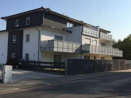 Erstbezug 4 Zimmerwohnung mit Terrasse und Garten bzw. Balkon und Kamin