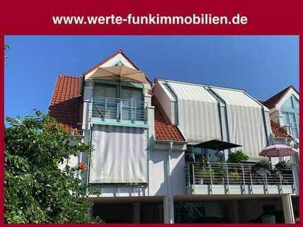 Exklusives Wohnambiente! Markant gestaltete Endetage-Maisonette mit Wintergarten in idealer Citylage