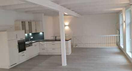 Imposante Zwei-Zimmer-Wohnung in zentraler Lage über zwei Ebenen