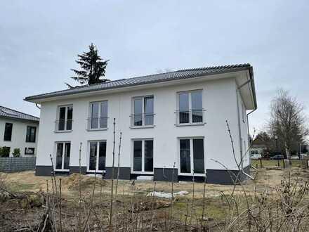 Doppelhaushälfte in Mahlsdorf als KFW 55 Haus.