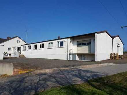 Großes Betriebs- und Lagergebäude in optimaler Autobahnnähe (440 qm NF) + 1 / 2 Familien-Wohnhaus