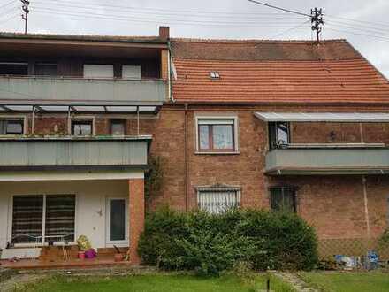Mehrfamilienhaus 3 Wohnungen und 3 Garagen mit Garten + 100 qm Nutzfläche