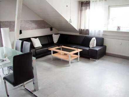 Gepflegte 3-Zimmer-Dachgeschosswohnung mit Einbauküche und kleinem Garten in Waghäusel
