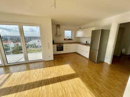Wohlfühlwohnung mit 2 Balkonen und TG, Neubau!