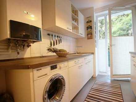 Schöne 2-Zimmer Wohnung mit EBK, Terasse und Garten