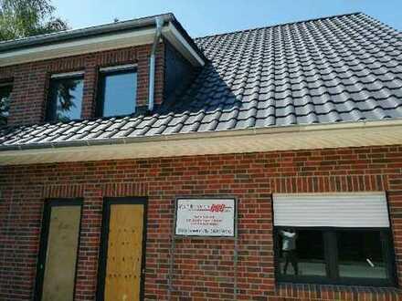 Neubau Doppelhaushälfte mit 2 Eigentumswohnungen in KfW-55 Ausführung