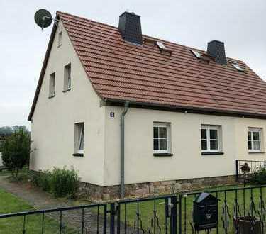Wohnen am Stadtrand mit idealer Zentrumsanbindung: DHH mit Garten und Garage in Dresden-Kauscha