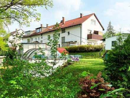 Mehrfamilienhaus mit Ladengeschäft plus Baugrund direkt am Landschaftsschutzgebiet!