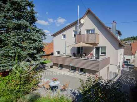 Idyllisches Mehrfamilienhaus mit hochwertigen Küchen, schönen Badezimmern, großem Garten und Keller