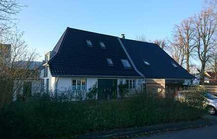 Neuwertige Terrassenwohnung mit drei Zimmern und EBK in Flensburg