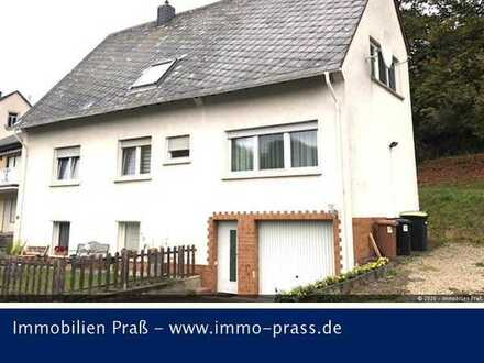 Top-Gelegenheit! Zweifamilienhaus mit separatem Gartengrundstück in Bärenbach zu verkaufen.
