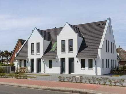 Strandnah gelegener Neubau mit 3 Ferien- und einer Dauerwohnung