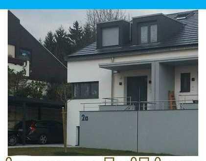 Modernes Einfamilienhaus in grüner Hanglage