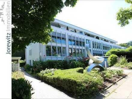 Bi-West - Wohnen am Oetkerpark: 4 Zimmer-Wohnung mit Einbauküche, Balkon und Wintergarten