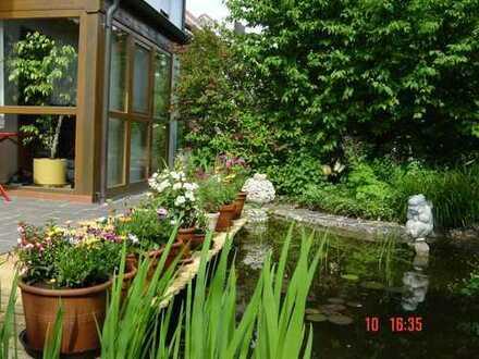 Gartenwohnung mit Teich