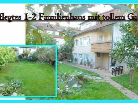 **Gepflegtes 1-2-Familienhaus mit tollem Garten in Ortsrandlage**