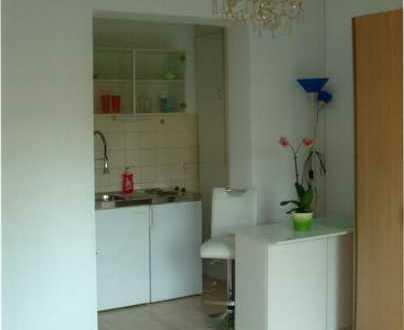 Geschmackvolle und geräumige Wohnung mit einem Zimmer sowie Balkon und Einbauküche in Heidelberg