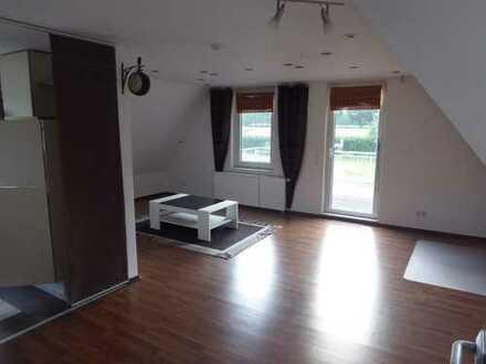 Gepflegte 4-Zimmer-Dachgeschosswohnung mit Balkon und Einbauküche in Ganderkesee, OT Hoykenkamp