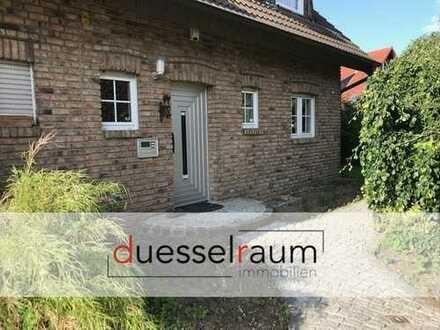 großzügig geschnittene Doppelhaushälfte mit Garten und Kamin!