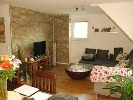 Helle Maisonette-Wohnung mit Süd-Terrasse