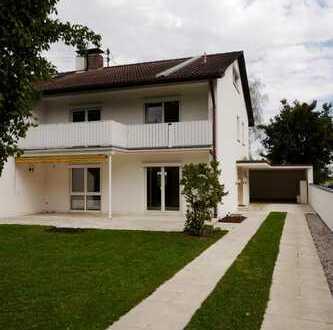 CASACONCEPT Große attraktive Doppelhaushälfte auf sonnigem Grundstück in Dornach