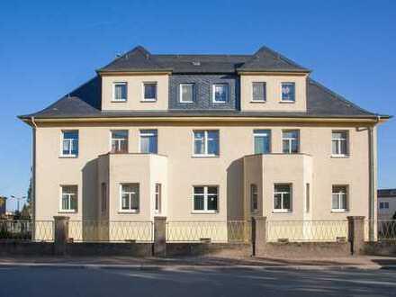 Wohngebäude mit Geschäftsunterlagerung
