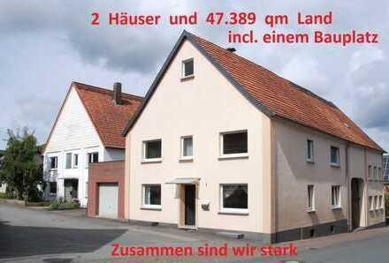 2 Nebeneinander liegende Häuser mit Bauplatz und 47.389 qm Grundstück