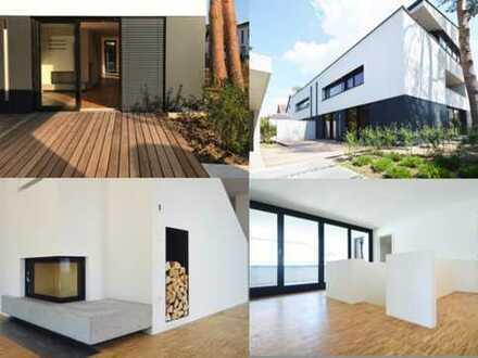 Außergewöhnlich in Architektur und Ausstattung - Neubau-Maisonette mit Garten