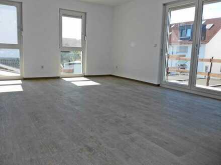 6160 - Herrliche Neubauwohnung mit Balkon und Stellplatz!