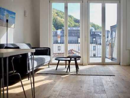 Möblierte Dachgeschoss-Whg mit Südbalkon & Tiefgarage