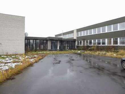 Großes Gewerbegrundstück (9.211 m²) mit ca. 1.600 m² Bürofläche und großem Parkplatz in Queckborn