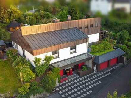 Architektenhaus mit Wintergarten. Hell und großzügig. Für Familien und Selbständige.