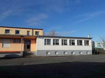 Gewerbegrundstück in Brandenburg, bebaut mit einem Gebäude (vollunterkellert) und 4 Garagen