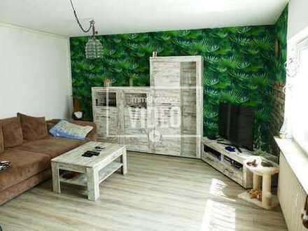 Drei Zimmerwohnung mit Wintergarten, Garten und Garage