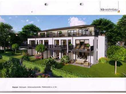 Wohnen in zentr. Lage/Erstbezug - Helle 3 ZKB/EG-Wohnung mit überdachter Terrasse und 140 m² Garten