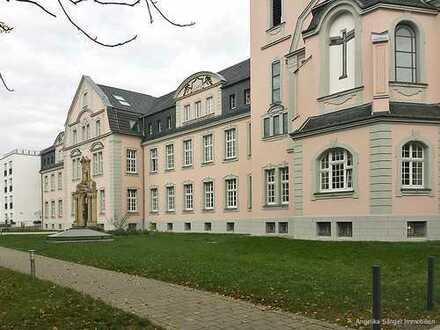 Für Kapitalanleger: Gut vermietete 2-Zimmerwohnung mit Balkon im Marianum.