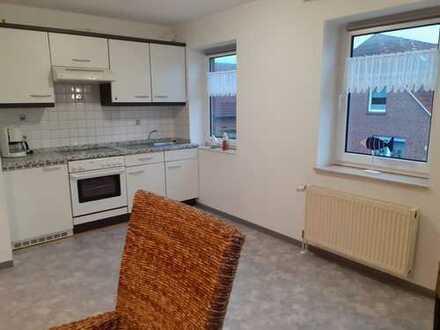 Schöne, geräumige ein Zimmer Wohnung mit Balkon in Neuharlingersiel direkt an der Nordseeküste